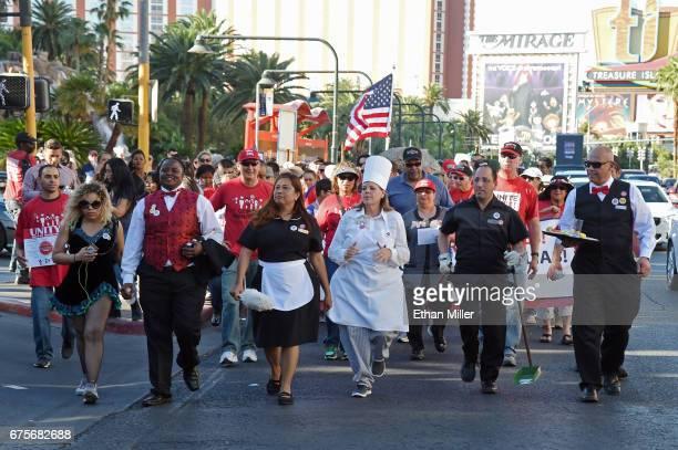 Union members Jennifer Patino Vernisha Ward Nympha Camacho Glenna Bolster David Saba and Jose Rivera lead a May Day march on the Las Vegas Strip on...