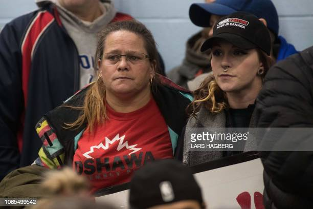 Union members look on as union leaders talk about the closing plant at Local 222 in Oshawa Ontario on November 26 2018 In a massive restructuring US...