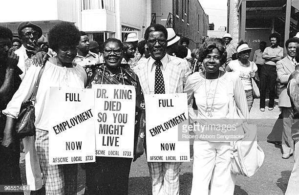 Union members of AFSCME local 1733 gather to protest unfair labor practices Memphis TN 1976 Demonstrators hold up signs that read 'Full Employment...