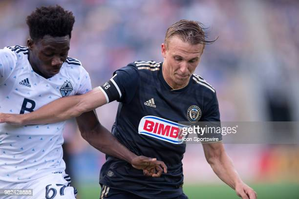 Union Midfielder Borek Dockal battles with Whitecaps Midfielder Alphonso Davies for position in the first half during the game between Vancouver...