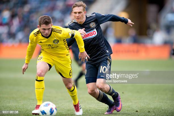 Union Midfielder Borek Dockal chases after Columbus Crew Midfielder Wil Trapp in the second half during the game between the Columbus Crew and...