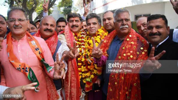 Union Minister and BJP Candidate Jugal Kishore Sharma shows victory sign as he arrives to file his nomination for JammuPoonch constituency ahead of...