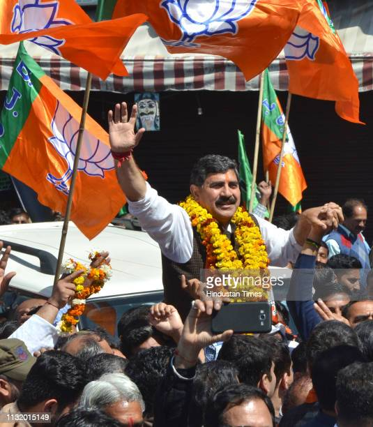 Union Minister and BJP Candidate Jugal Kishore Sharma waves at supporters as he arrives to file his nomination for JammuPoonch constituency ahead of...