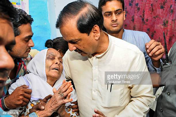 Union Minister and BJP leader Mahesh Sharma visits the family of the Mohammad Akhlaq who was killed by a mob on the night of September 28 following...