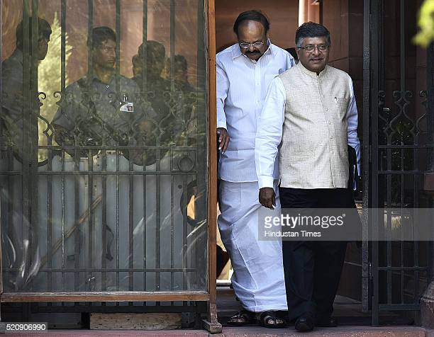 Union Minister and BJP leader Venkaiah Naidu along with Minister of Communications and Information Technology Ravi Shankar Prasad coming out after...