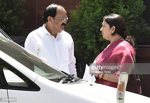 Union Minister and BJP leader Venkaiah Naidu along with Union Minister for Human Resource Development Smriti Irani coming out after attending the...