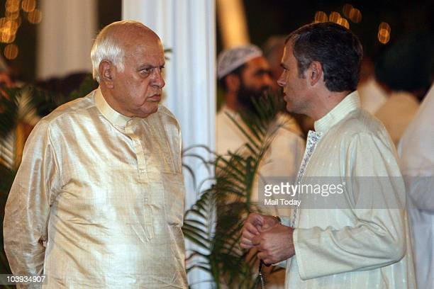 Union minister Farooq Abdullah seems to be in a serious mood as he meets his son Omar Abdullah at the PM's iftar party on September 8 2010