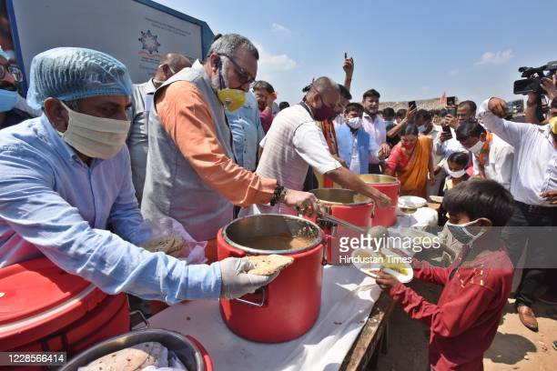 Union Minister Giriraj Singh seen serving food to Hindu refugees from Pakistan on the occasion of Prime Minister Narendra Modis 70th birth...