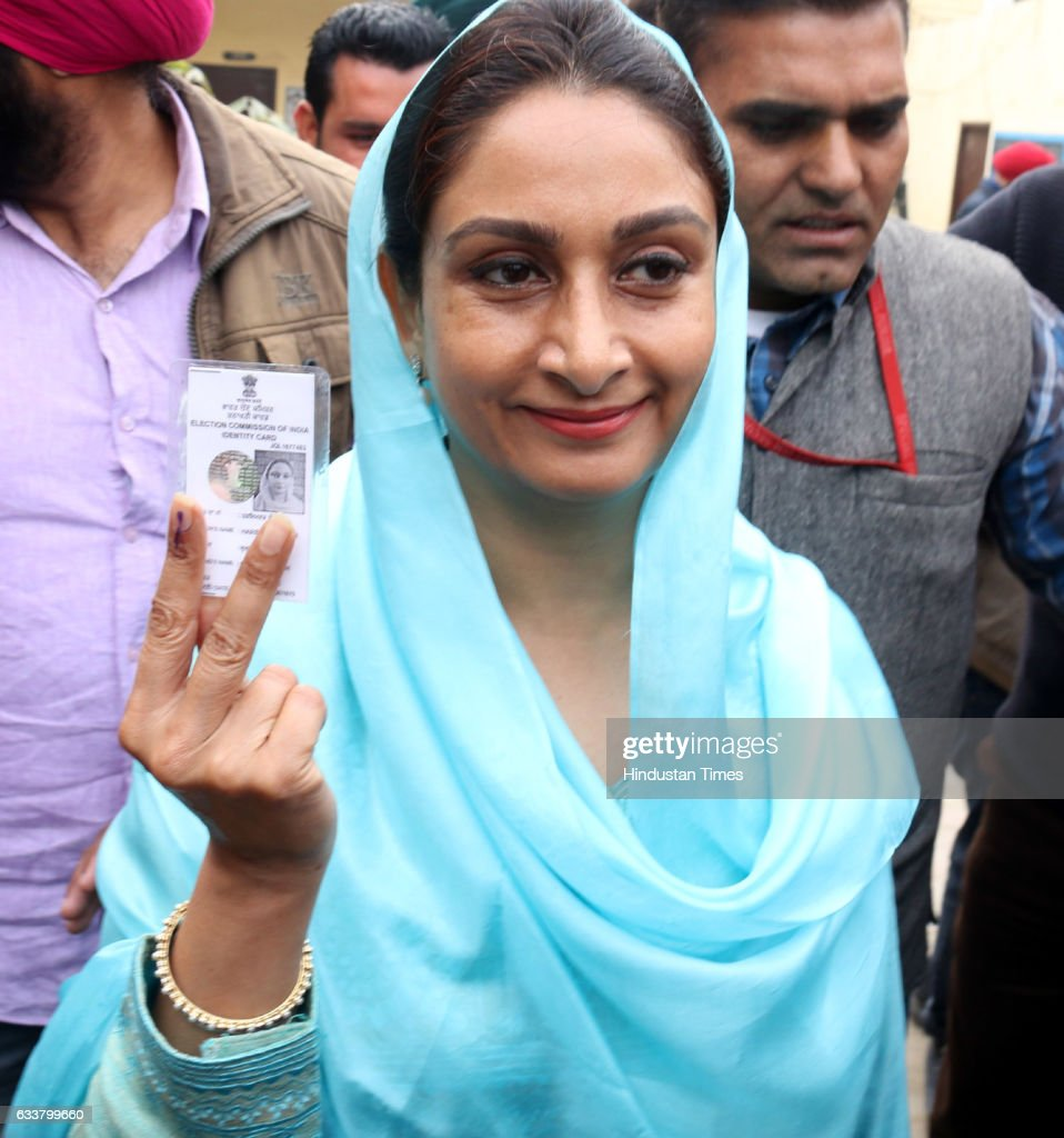 Union Minister Harsimrat Kaur Badal showing her voter card outside polling booth at Badal village on February 4 2017 in Lambi India Punjab on...