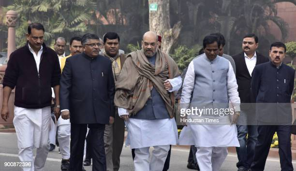Union Minister holding Law and Justice and Electronics and Information Technology Ravi Shankar Prasad BJP President and Rajya Sabha MP Amit Shah and...