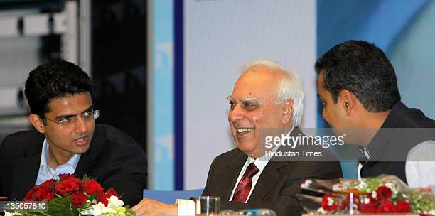 Union Minister of Communications and Information Technology Kapil Sibal along with Ministers of State Sachin Pilot and Milind Deora participate...