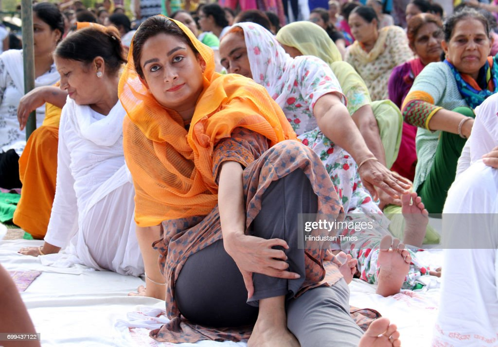 Union Minister of Food Processing Harsimrat Kaur Badal takes part in a mass yoga event on the World Yoga Day on June 21 2017 in Bathinda India