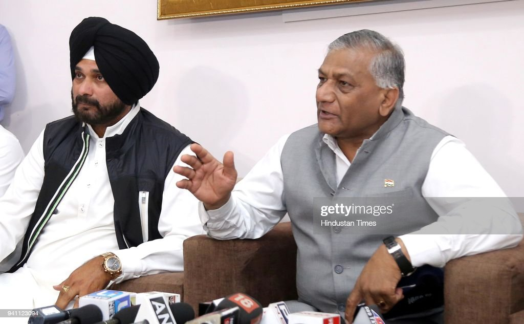 Union Minister Of State For External Affairs General VK Singh with Punjab Local Bodies Minister Navjot Singh Sidhu addressing a press conference at...