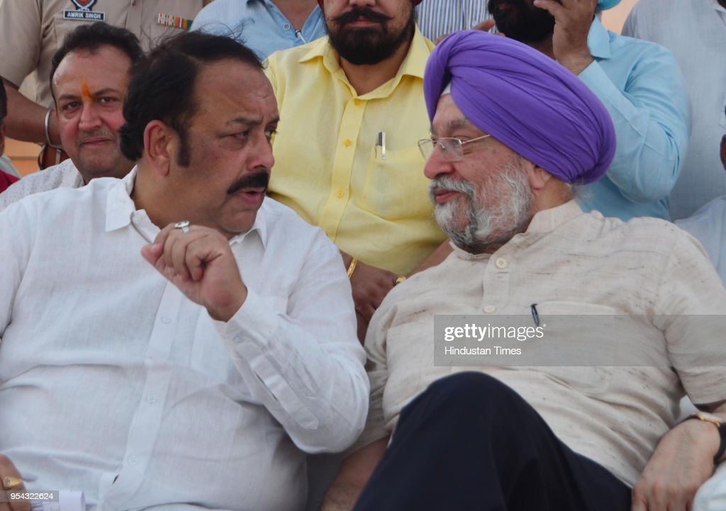 Union Minister Of State For Housing And Urban Affairs Hardeep Singh Puri and BJP Punjab State president Shwait Malik during a Gas connection...