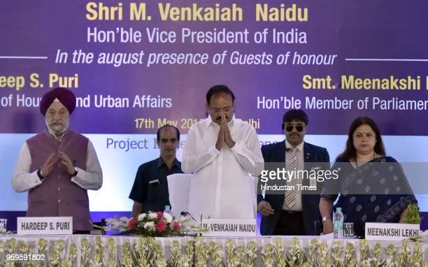 Union Minister of State of Housing and Urban Affairs Hardeep Singh Puri Vice President of India M Venkaiah Naidu and Lok Sabha MP Meenakashi Lekhi...