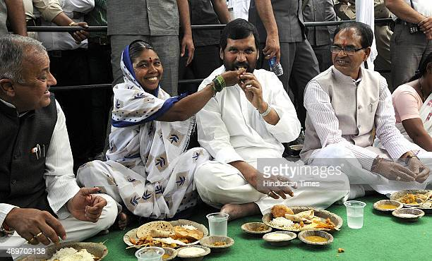Union Minister Ram Vilas Paswan and Madhya Pradesh Chief minister Shivraj Singh Chouhan having lunch with dalits on birth anniversary of Dr BR...
