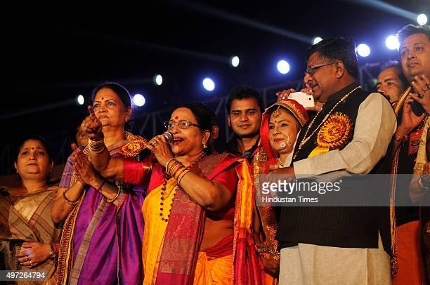 Union Minister Ravi Shankar Prasad along with Bhojpuri singers Sharada Sinha and Malini Awasthi during the Chhath Puja musical concert organized at a...