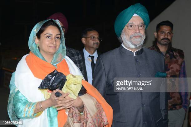Union Ministers Harsimrat Kaur Badal and Hardeep Singh Puri arrive after attending the groundbreaking ceremony for the Kartarpur Corridor at the...