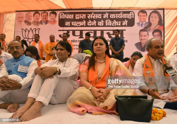 Union ministers Suresh Prabhu Vijay Goel Anant Geete Narender Tomar BJP MP Meenakshi Lekhi and other leaders during a protest against the disruption...