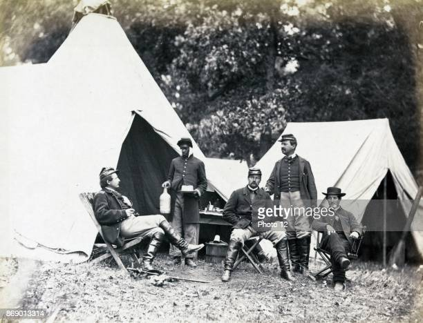 Union officers rest while their africanAmerican orderly serves drinks Warrenton Virginia during the American Civil War 1862