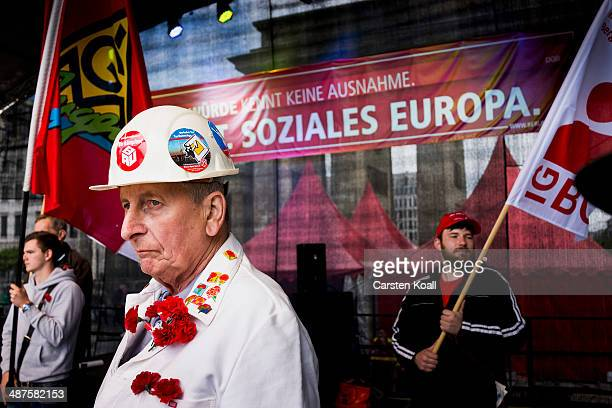 DGB union official Werner Klump attends a meeting at the Brandenburg Gate after marching through the city center on May 1 2014 in Berlin Germany May...