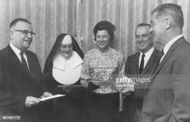 Union Pacific Gives $57000 Arthur Z Gray right from left are Dr Chester M Alter Sister Mary Kiernan Mrs Darrell J Hamilton and Frank H Ricketson Jr...