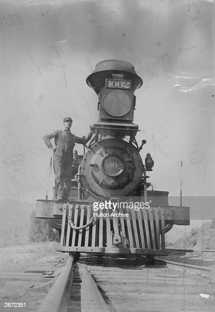 A Union Pacific Rail Road locomotive in Utah with a 'cowcatcher' fixed to its front for removing cows that wander onto the railway line or to shunt...