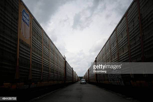 Union Pacific Railroad auto racks wait to transport Daimler AG Mercedes Benz vehicles from the company's international assembly plant in Vance...