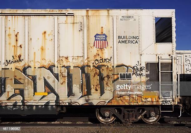 Union Pacific Railroad boxcars vandalized with graffiti sit on a siding in Idaho Falls, Idaho.