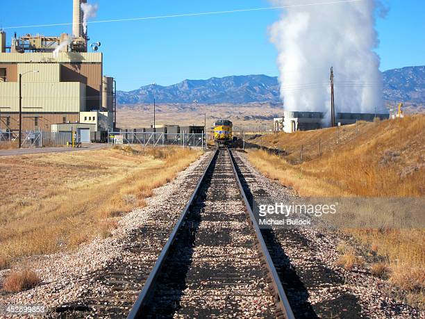 Union Pacific switching, diesel locomotive moving slowly releasing coal from Colorado Springs Utilities cars at the Nixon Power Plant in Fountain,...