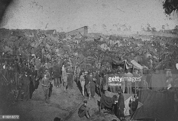 Union prisoners are waiting to draw rations at the main gate of Andersonville prison in Georgia during the US Civil War