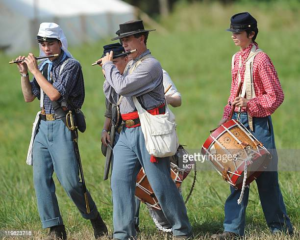 Union reenactors in a drum and fife group head out to the battlefield for the reenactment of the 150th anniversary of the Civil War's First Battle of...