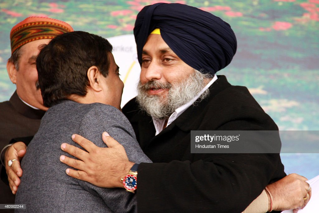 Union Road Transport Highways and Shipping Minister Nitin Gadkari and Punjab Deputy Chief Minister Sukhbir Singh Badal hug eachother during function..
