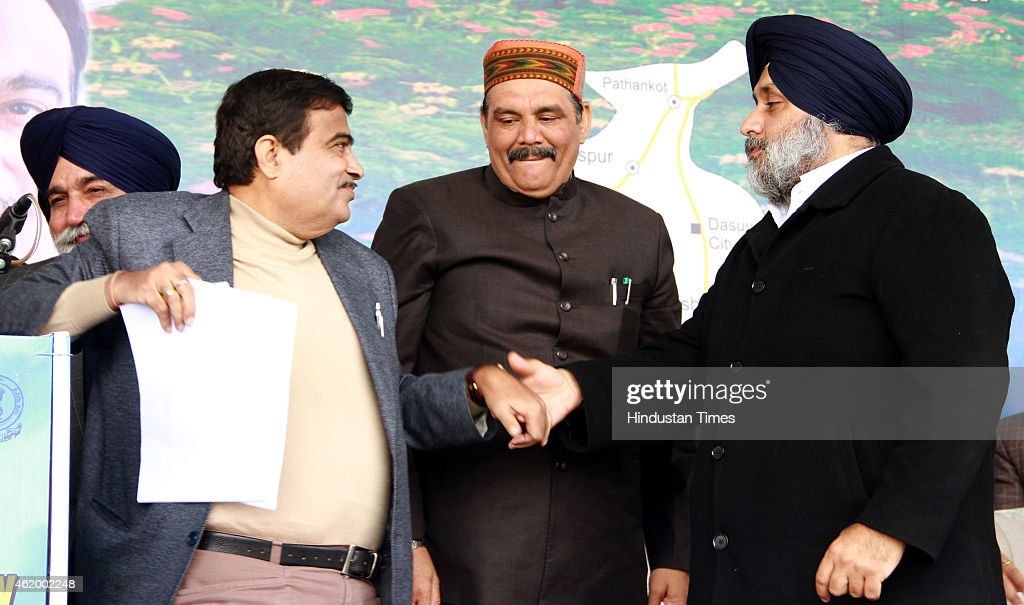 Union Road Transport Highways and Shipping Minister Nitin Gadkari and Punjab Deputy Chief Minister Sukhbir Singh Badal shaking hands during function..