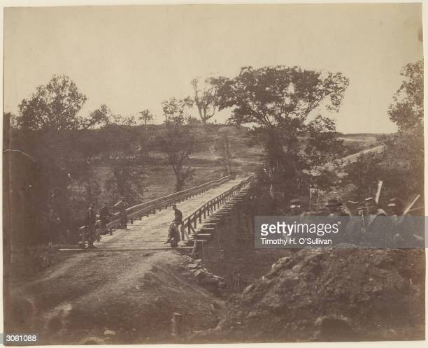 Union soldiers guard Chesterfield Bridge over the North Anna River in Virginia two days after capturing it from Confederate forces during the...