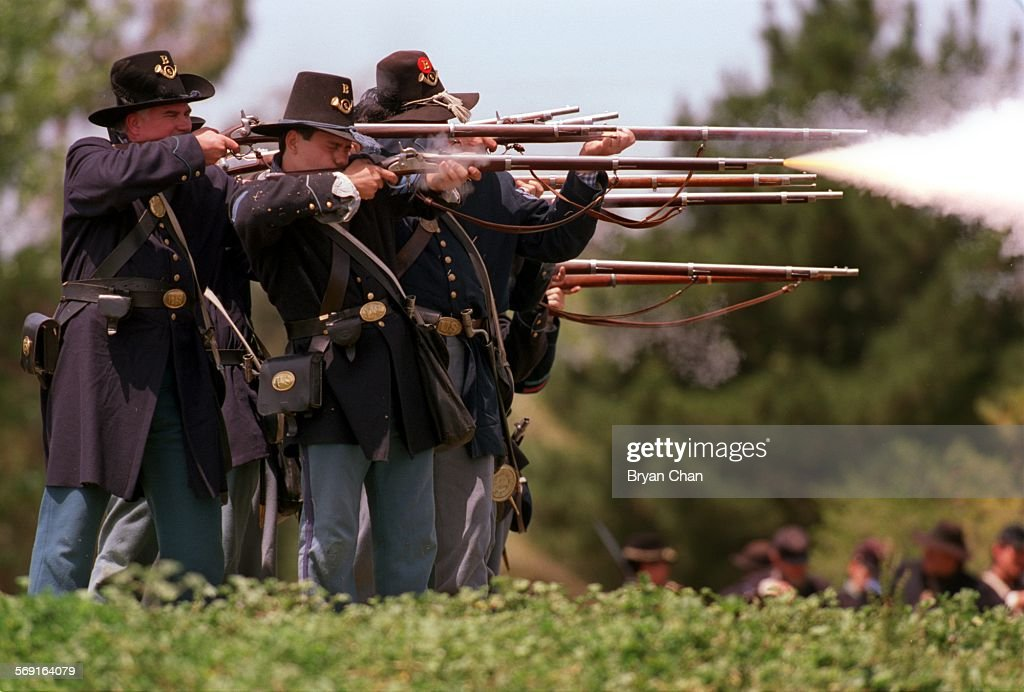 Union soldiers open up on attacking Confederates during a