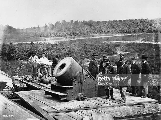 Union soldiers stand on a bridge in Petersburg Virginia The giant mortar 'Dictator' was used by the North during the American Civil War Original...