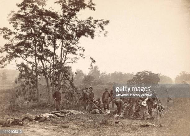 Union Soldiers Standing near the Bodies of Dead Confederate Soldiers while Awaiting Burial, Battle of Antietam, Antietam, Maryland, USA, Alexander...