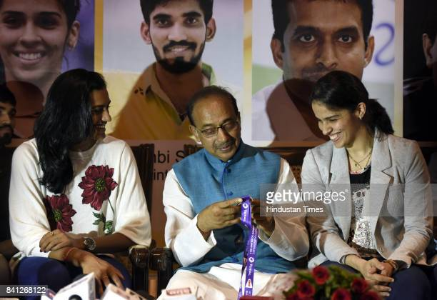 Union Sports Minister Vijay Goel talking to Badminton players Saina Nehwal PV Sindhu during the felicitation ceremony of Badminton players and his...