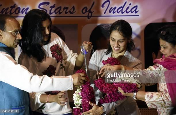 Union Sports Minister Vijay Goel with his wife Preeti Goel felicitates Badminton players Saina Nehwal PV Sindhu at his residence Ashoka Road on...