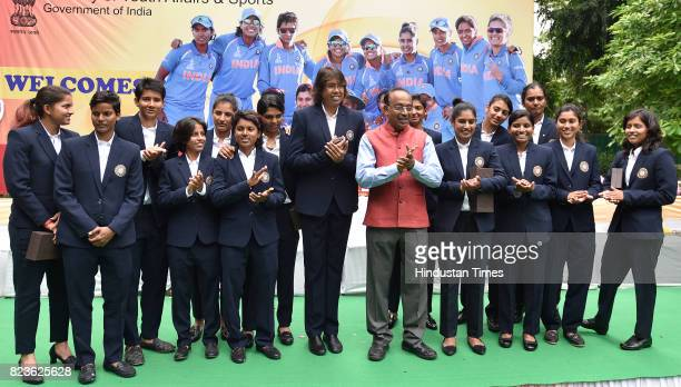 Union Sports Minister Vijay Goel with India Women's Cricket team at a felicitating event at his residence on July 27 2017 in New Delhi India Mithali...