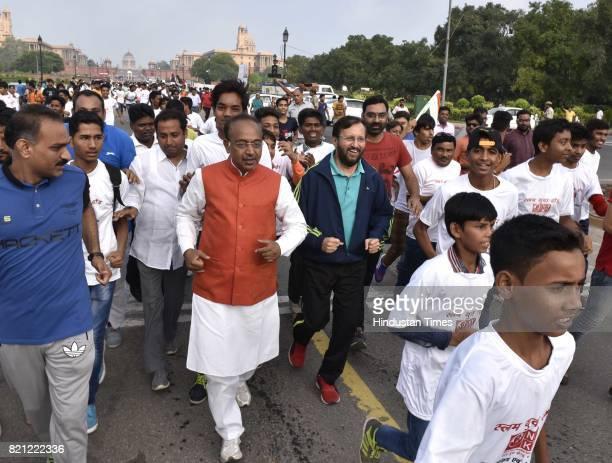 Union Sports Minister Vijay Goel with Union HRD Minister Prakash Javadekar participates in the 11th Slum Yuva Run at Rajpath on July 23 2017 in New...