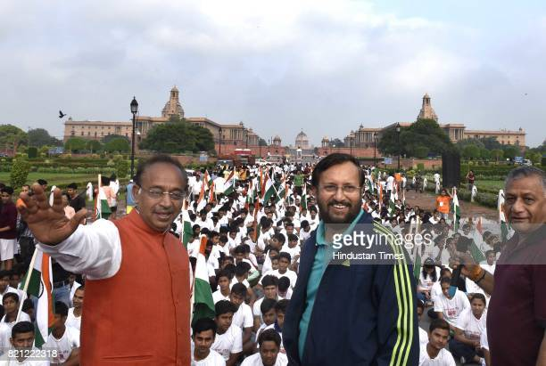 Union Sports Minister Vijay Goel with Union HRD Minister Prakash Javadekar Minister of State for External Affairs V K Singh flags off the 11th Slum...