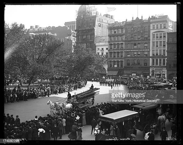 Union Square West Horse drawn fire apparatus in parade of firemenNew York New York late 1900s