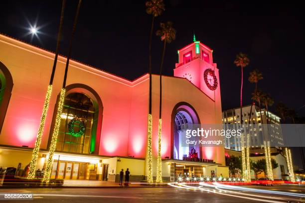 union station los angeles - holiday seasonal lighting and decorations - building exterior - union station los angeles stock photos and pictures