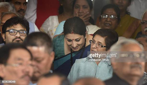 Union Textile Minister Smriti Irani talking with Kiren Bedi Lieutenant Governor of Puducherry after swearing in ceremony of the new president Ram...
