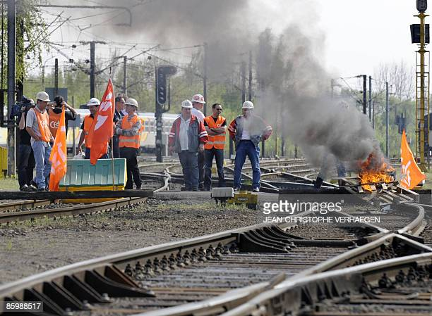Union trade members from an ArcelorMittal plant in Florange block the traffic at a train station to ask for negotiations with the management on April...