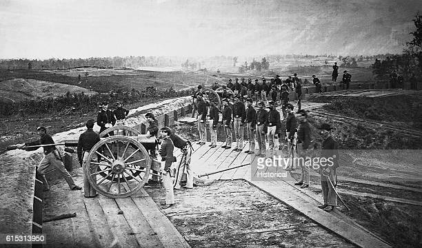 Union troops from Battery M 5th US Artillery stand next to a cannon in a rebel fort near Atlanta captured by General Sherman's armies General Sherman...