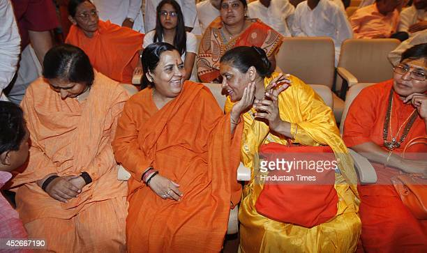 Union Water Resources Minister Uma Bharati with other sadhavis during prayer meeting to pay tribute to late VHP leader Giriraj Kishore at Chinmaya...
