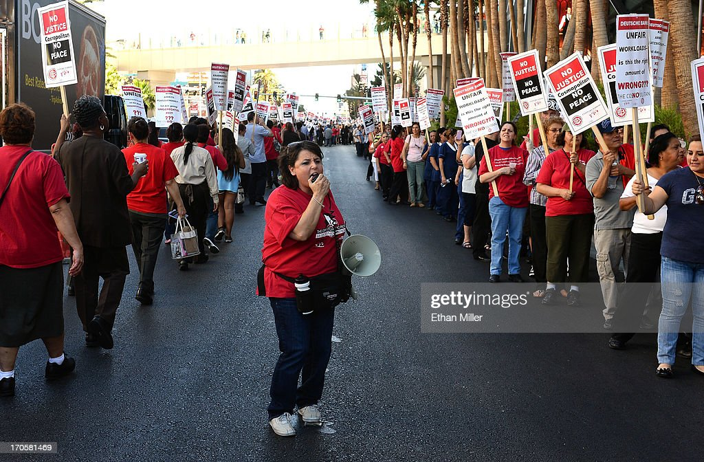 Union worker Jeannine Innuzzi (C) uses a megaphone to lead chants as workers picket on the Las Vegas Strip outside The Cosmopolitan of Las Vegas on June 14, 2013 in Las Vegas, Nevada. The demonstration is in response to stalled negotiations with the hotel-casino, where 2,000 members of the Culinary Workers Union have been without a contract for more than two years. The Culinary, which represents 55,000 workers, is also in negotiations with MGM Resorts International and Caesars Entertainment Corp.